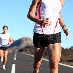 Running Sport. Runners on road in endurance run outdoors in beau